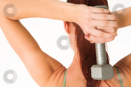Gym #1 stock photo, A woman in gym clothes, holding a weight behind her back. by Sean Nel