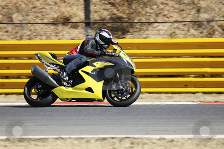 Superbike #65 stock photo, High speed Superbike on the circuit  by Sean Nel
