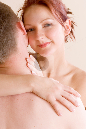 Couple #38 stock photo, Woman looking over the shoulder of her boyfriend by Sean Nel