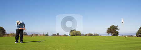 Golfer #51 stock photo, A golfer playing golf on a green by Sean Nel
