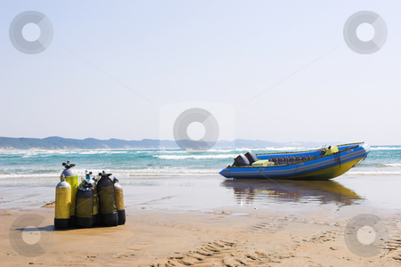 Sudwana #24 stock photo, The beach at Sudwana with diving equipment in the foreground and a motorboat in the background by Sean Nel