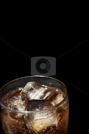Glass #7 stock photo, Glass with cooldrink and ice, black background - copy space by Sean Nel