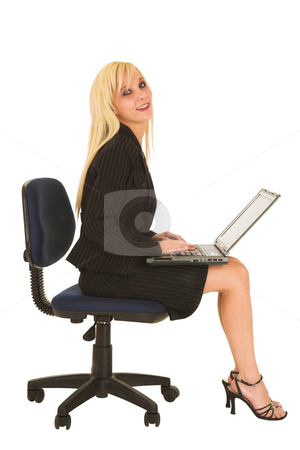 Business Woman in black #134 stock photo, Blond business woman in black dress business suit, sitting down, with notebook computer on her lap by Sean Nel