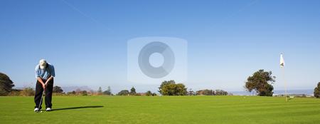 Golfer #48 stock photo, A golfer playing golf on a green by Sean Nel