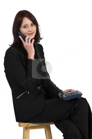 Luzaan Roodt #2 stock photo, Business woman in formal black suit, talking on phone by Sean Nel