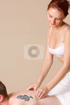 Massage #6 stock photo, Masseuse working on a man by Sean Nel
