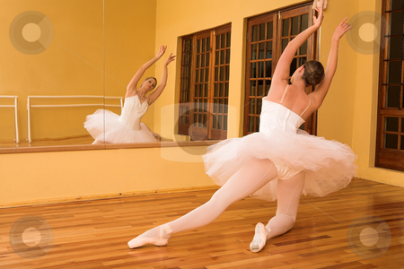 Ballerina #23 stock photo, Woman doing ballet infront of a mirror by Sean Nel