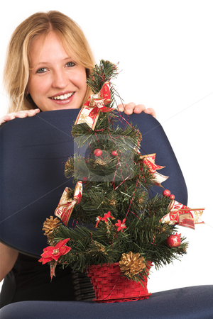 Business Woman #513 stock photo, Blond Pregnant Business Woman, wearing black top holding on to office chair with Christmas tree on chair, shallow depth of field, focus on Christmas tree by Sean Nel