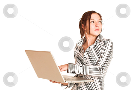 Business Woman #353 stock photo, Business woman with brown hair, dressed in a white shirt with black stripes.  Holding a laptop.  Copy space by Sean Nel