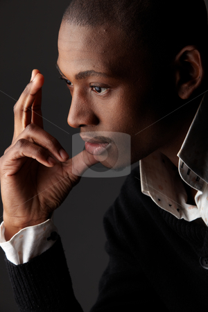Black African Businessman stock photo, Young black african businessman in a formal suite - high contrast by Sean Nel