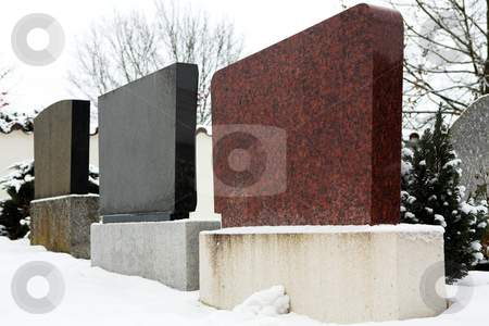 Kirchberg #03 stock photo, Gravestones in a row.  covered in snow.  Copy space. by Sean Nel
