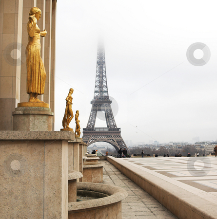 Paris #69 stock photo, A golden statue in the foreground with the Eiffel Tower in Paris, France.  Copy space. by Sean Nel