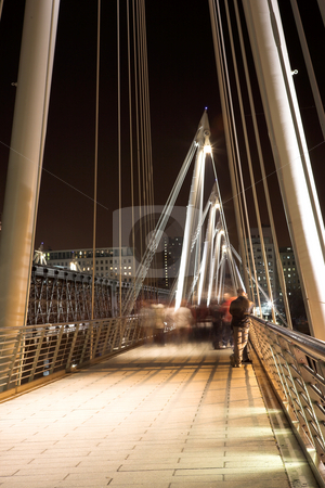 London#30 stock photo, Bridge in London at nighttime.  Movement on people walking. by Sean Nel