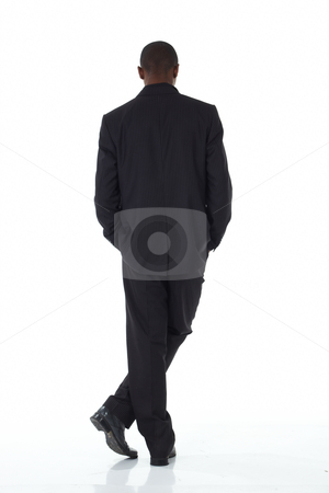 Black African businessman stock photo, Young Adult black african businessman wearing a dark smart-casual suit on a white background in various poses with various facial expressions. Part of a series, Not Isolated. by Sean Nel