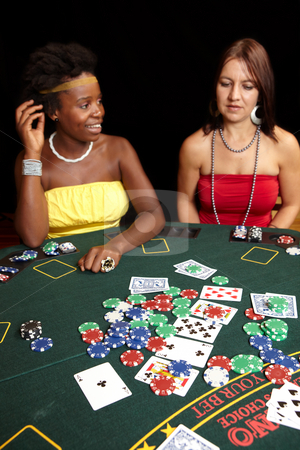 Card gambling stock photo, Woman playing cards, chips and players gambling around a green felt poker table. Shallow Depth of field by Sean Nel