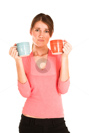 Business Woman #430 stock photo, Brunette business woman in  an informal light pink shirt.  Holding two mugs, looking confused. by Sean Nel