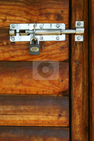 Locked door #8 stock photo, Padlock on a wooden door by Sean Nel
