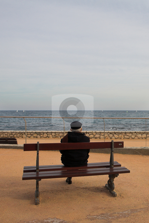 Benchman #03 stock photo, Lonely man on Bench, next to the sea by Sean Nel