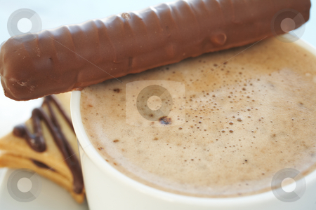 Cafe latte in coffee cup stock photo, Fresh foamy cafe latte in white coffee cup on a silver background with a chocolate biscuit and chocolate bar ? Shallow Depth of Field, focus on Foam by Sean Nel