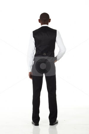 Black African Businessman stock photo, Young black african businessman in a formal suite and on a white background shot from behind - NOT ISOLATED by Sean Nel