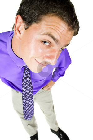 Young adult businessman with distorted perspective stock photo, Young adult businessman standing looking up with a distorted perspective caused by a wideangle lens. He is smiling and in office wear, and is isolated on white so that he can be added to composition images with copy space. by Sean Nel