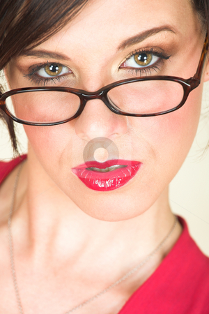 Young adult businesswoman stock photo, Young Caucasian adult businesswoman in a red, discreet, office wear with glasses, brown eyes, and red lips by Sean Nel