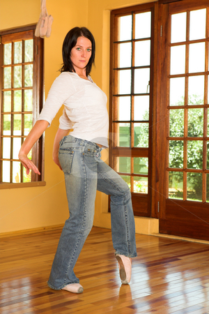 Modern Dancer #6 stock photo, Modern Ballet Dancer in blue jeans and Pointe Shoes. Practicing in Studio by Sean Nel