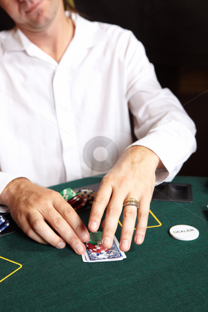 Card gambling stock photo, People playing cards, chips and players gambling around a green felt poker table. Shallow Depth of field by Sean Nel