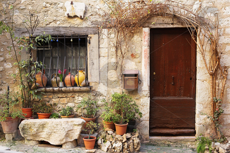 Village of St Paul stock photo, Street garden with Street name and potted plants in front of windows and doors in the quaint little French hilltop village of Saint-Paul de Vence, Southern France,  Alpes Maritimes, next to the Mediterranean sea - a Heritage Site by Sean Nel