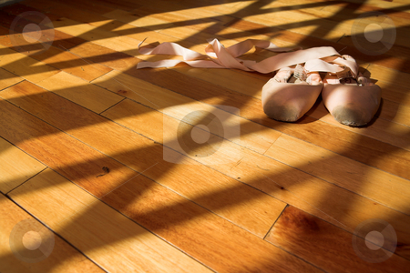 Pointe Shoes #6 stock photo, Pair of Ballet shoes lying on a wooden studio floor by Sean Nel