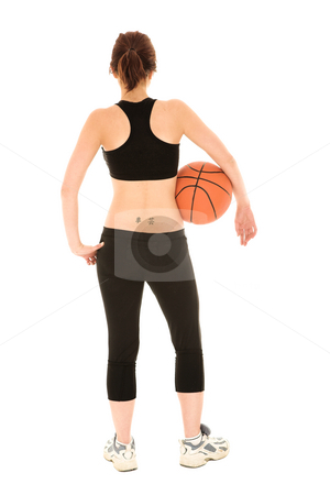 Sexy brunette fitness woman stock photo, Sexy young adult Caucasian woman in a black training wear with a basketball under her arm. NOT ISOLATED by Sean Nel