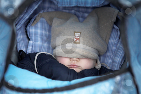 Munich #47 stock photo, Baby in a pram with hat over his eyes.  Shallow DOF. by Sean Nel