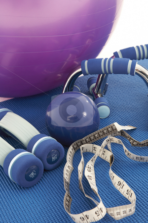 Fitness Equipment stock photo, Collection of fitness equipment on a soft yoga matt by Sean Nel