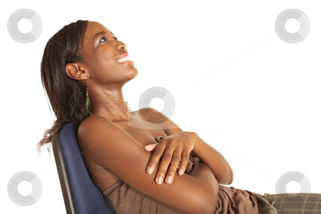 Cynthia Akva #11 stock photo, African business woman dressed in neutral coloured clothes. Sitting on office chair - smiling.  Copy Space by Sean Nel