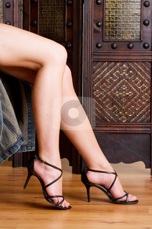Legs #3 stock photo, Beautiful, long legs with black sandals on a wooden floor by Sean Nel