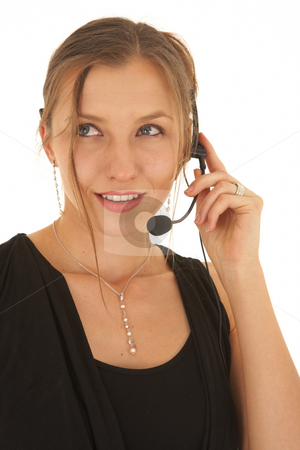Beautiful Caucasian businesswoman stock photo, Portrait of a beautiful young Caucasian businesswoman wearing phone headset on white background. NOT ISOLATED by Sean Nel