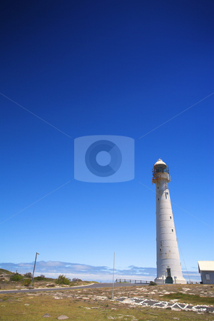 Lighthouse against a blue sky stock photo, The Slangkop Lighthouse at Kommetjie, Western Cape. The Tallest Lighthouse in South Africa by Sean Nel