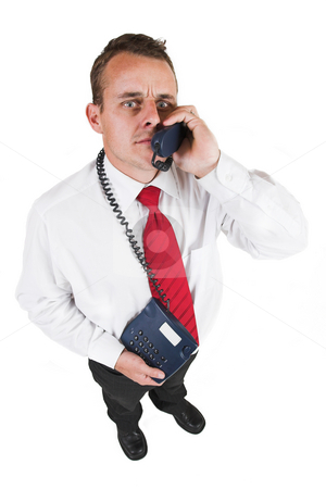 Tollie Booysen #24 stock photo, Businessman in blacktrousers, pants, white shirt and red tie.Talking on the phone, looking up. by Sean Nel