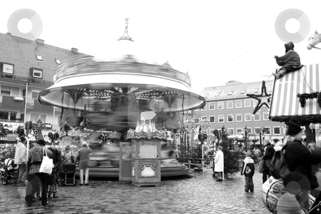Merry-go-round stock photo, Merry-go-round in Neurenburg - Munich at Christmas time.  Movement on people and merry-go-round.  Black-and-white. by Sean Nel