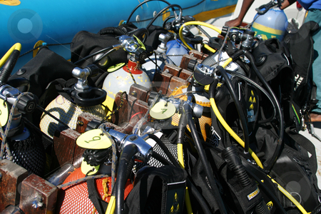 Stacked Scuba Gear stock photo, Divers Scuba Gear stacked and tied down on the dive boat by Sean Nel