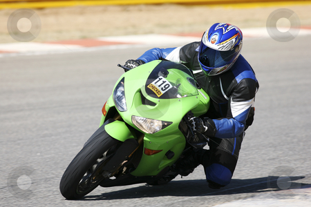 Superbike #56 stock photo, High speed Superbike on the circuit  by Sean Nel