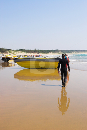 Sudwana #13 stock photo, A diver walking towards a rubber boat. by Sean Nel