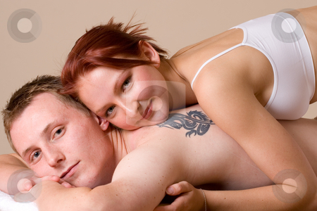 Couple #5 stock photo, Girl lying on the back of her boyfriend by Sean Nel