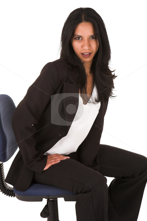 Young adult businesswoman stock photo, Beautiful young adult Indian businesswoman with dark skin and dark straight long hair, brown eyes and pink lips, wearing a black suit with pants by Sean Nel