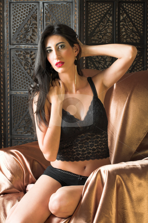 Sexy Italian woman stock photo, Beautiful young sexy adult Italian woman with long black hair, in black lace lingerie on a textured wooden background ? Hard light, high key by Sean Nel
