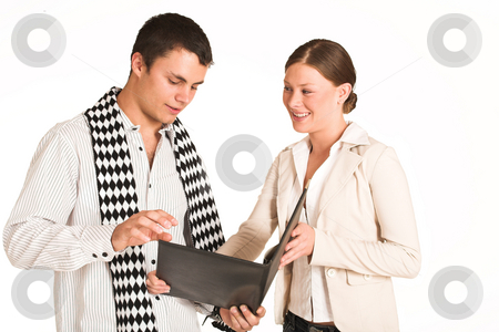 Business People #34(FG) stock photo, Two business partners: one woman and one man.  Looking at file. by Sean Nel