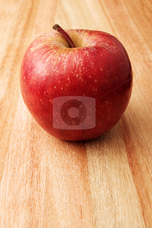 Apple #4 stock photo, Red apple on wooden cutting board - copy space by Sean Nel