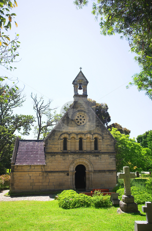 Old church with a cemetery stock photo, Old church in Knysna, South Africa, with a cemetery in green gardens by Sean Nel