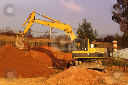 Earthmoving Equipment stock photo, Yellow caterpillar digging by Sean Nel