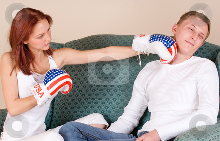 Couple #44 stock photo, Woman hitting her boyfriend with boxing gloves by Sean Nel